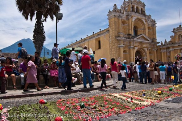 Waiting for the procession to leave Hermano Pedro church. View of Volcán de Agua in the background. Antigua, Guatemala
