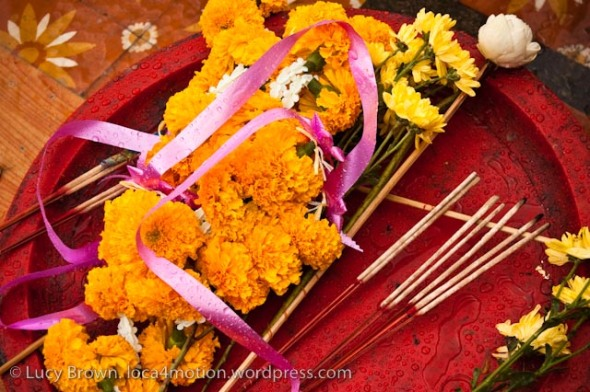 Temple offerings: marigolds, incense & lotus flower, Chiang Mai, Thailand