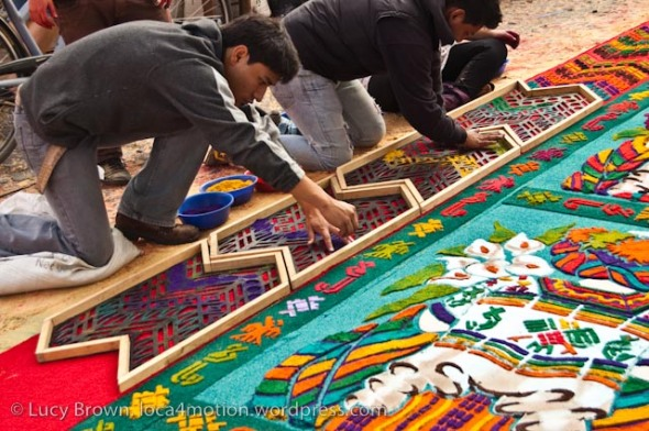 Using wooden stencils for intricate dyed sawdust alfombra, Antigua, Guatemala