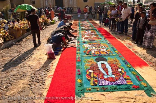 Showing scale and intricacy of dyed sawdust alfombra, Antigua, Guatemala