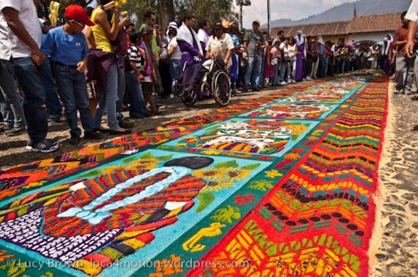 Crowds admiring the completed alfombra moments before the procession walks over it, Antigua, Guatemala
