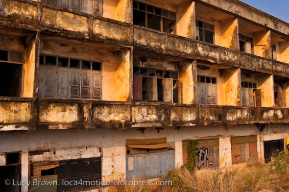 Sunset lit derelict buildings along the Mekong riverbank, Vientiane, Laos