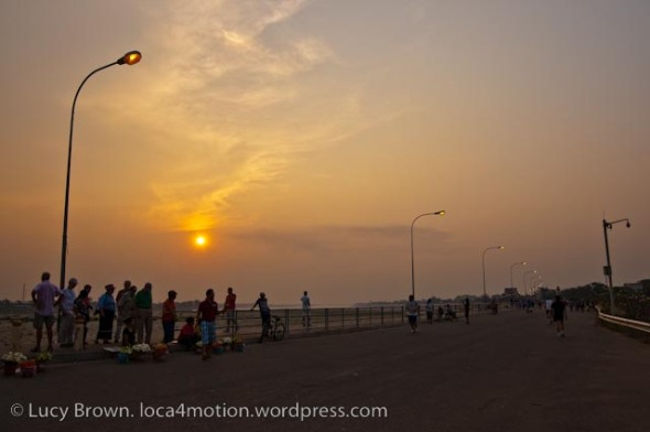 Leisure time at sunset along the Mekong riverbank, Vientiane, Laos