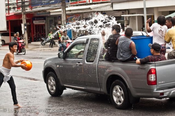 Pickup truck armed with barrel of water gets a drenching, Songkran (Thai New Year), Karon, Phuket, Thailand