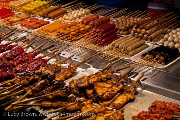 Meats and fish on sticks, street food, Thailand