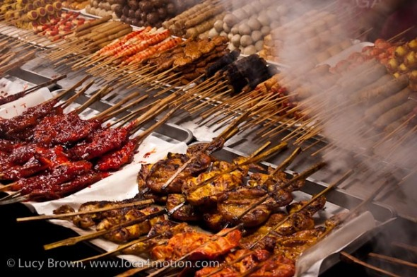 Assortment of grilled meats and fish on sticks, street food, Thailand