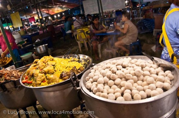 Yellow khao mok gai (a muslim dish with chicken) and meat balls, street food, Thailand