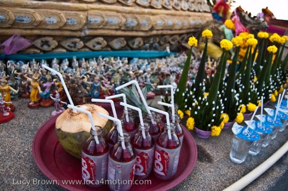 Offerings, naga shrine (pa ya nak), Karon beach, Phuket, Thailand