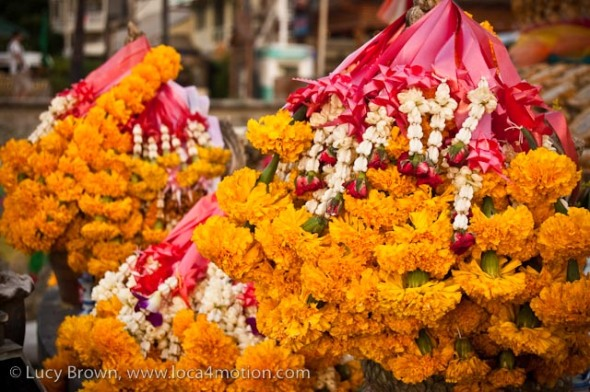 Marigold, garland, naga shrine, Karon beach, Phuket, Thailand
