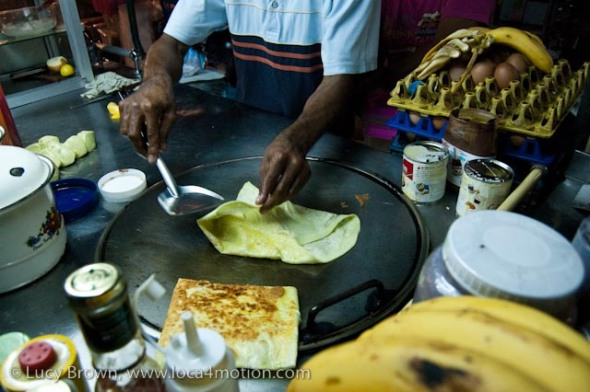 Folding a roti, desserts, Thailand