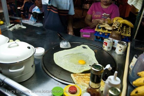 Making roti on a street cart, desserts, Thailand