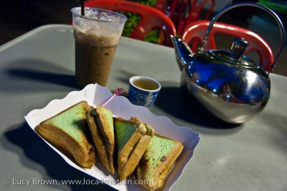Kanom pan ping (toasted bread drenched with condensed milk and sprinkled with sugar), iced coffee, and Chinese tea at a night stall, desserts, Thailand