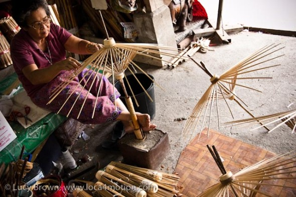 Fixing bamboo spokes to make parasol frames, traditional Thai parasols, Chiang Mai, Thailand