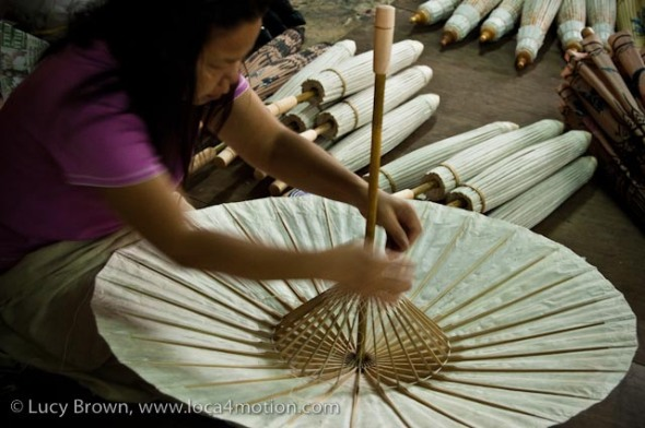 Fixing bamboo spokes on parasol, traditional Thai parasols, Chiang Mai, Thailand
