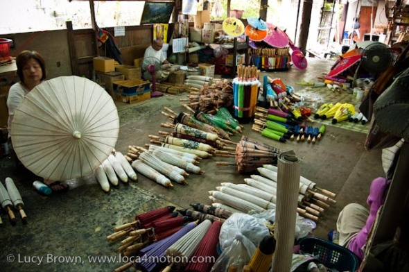 Artisans at work in parasol workshop, traditional Thai parasols, Chiang Mai, Thailand