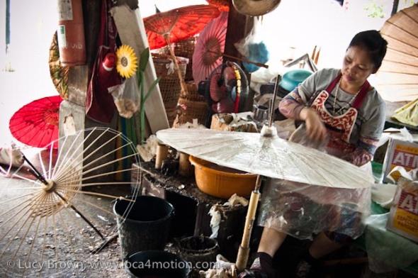Glueing sa paper to parasol frame, traditional Thai parasols, Chiang Mai, Thailand