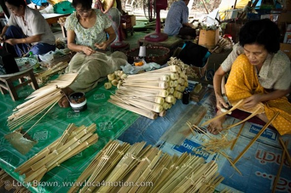 Cutting bamboo spokes for parasol frames, traditional Thai parasols, Chiang Mai, Thailand