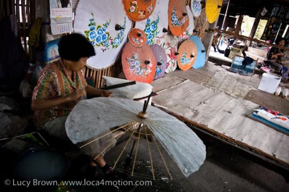 Glueing pieces of sa paper to parasol frame, traditional Thai parasols, Chiang Mai, Thailand