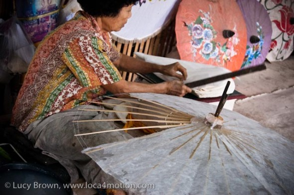 Close-up of glueing sa paper to parasol frame, traditional Thai parasols, Chiang Mai, Thailand