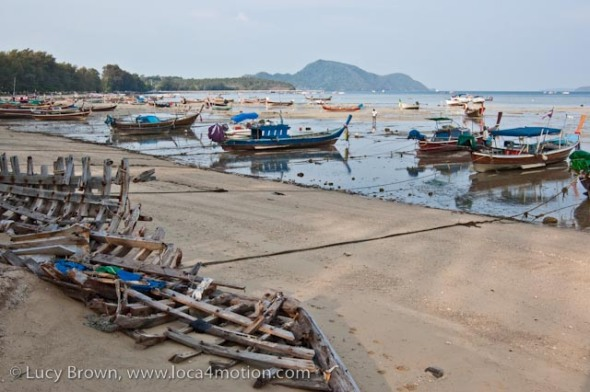Long-tail boats (ruea hang yao), low tide, Rawai beach, Phuket, Thailand