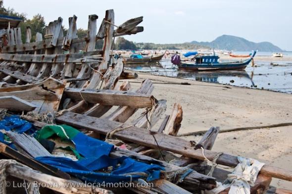 Long-tail boats (ruea hang yao), low tide, Rawai beach, Phuket, Thailand