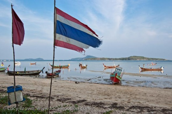 Long-tail boats (ruea hang yao), Thai flag, Rawai beach, Phuket, Thailand