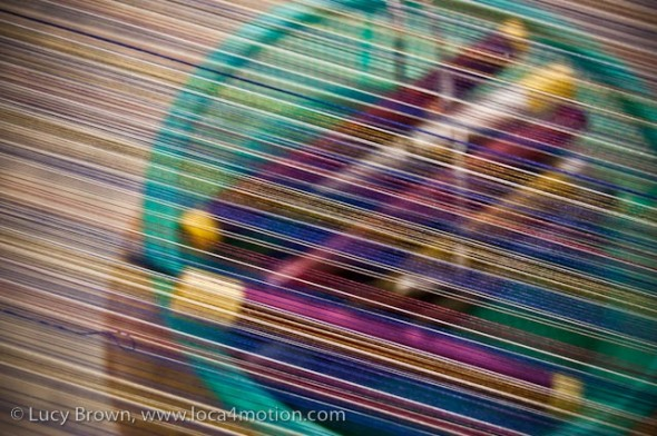 Close-up of spindles of Thai silk thread seen through threads on loom, Chiang Mai, Thailand