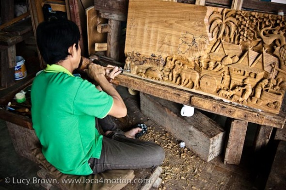 Carving a rural Thai scene in teak, wood carving, Chiang Mai, Thailand