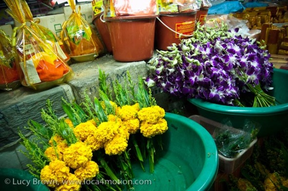 Orchid & marigold bunches & temple offerings, morning market, Krabi town, Krabi, Thailand