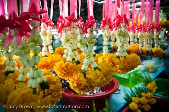 Selling jasmine & marigold garlands, morning market, Krabi town, Krabi, Thailand