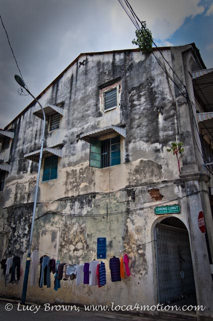 Old building with washing line in the street, George Town, Penang, Malaysia