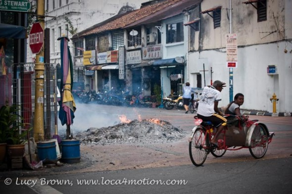 Festival fire in street outside Kong Hock Keong or Goddess of Mercy Temple, George Town, Penang, Malaysia