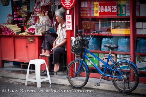 Temple goods store seller, Kong Hock Keong or Goddess of Mercy Temple, George Town, Penang, Malaysia