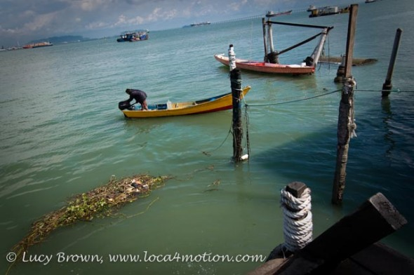 Boats at end of jetty, Chew Jetty, Clan Jetties, George Town, Penang, Malaysia