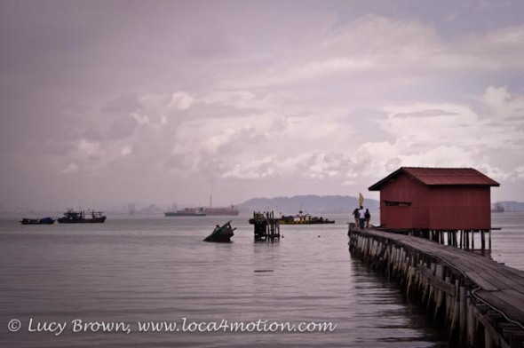Sunken boat at end of jetty, Clan Jetties, George Town, Penang, Malaysia