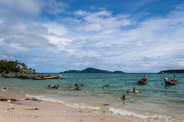 Children playing in the sea at the Sea Gypsy village, Rawai, Phuket, Thailand