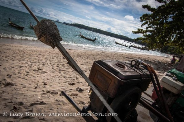 Dead puffer fish stabbed on long-tail boat engine shaft on the beach near the Sea Gypsy village, Rawai, Phuket, Thailand