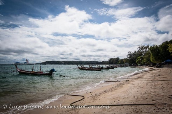 Long-tail boats moored off the beach at the Sea Gypsy village, Rawai, Phuket, Thailand