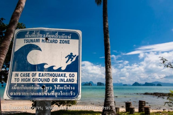 Tsunami hazard sign on beach, Ko Yao Noi, Phuket, Thailand