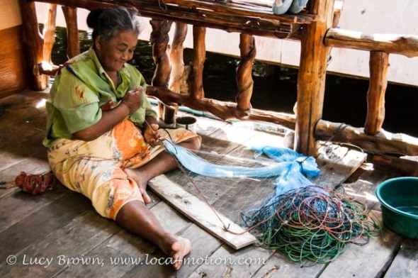 Local woman mending fishing nets, Koh Panyee (Ko Panyi), Phang Nga Bay, Thailand