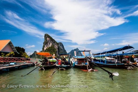 Long-tail boats & limestone karsts, Koh Panyee (Ko Panyi), Phang Nga Bay, Thailand