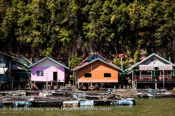Colorful floating houses, boats and fish traps, Koh Panyee (Ko Panyi), Phang Nga Bay, Thailand