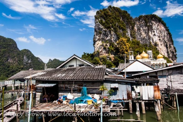 Houses on stilts, mosque and limestone karsts, view from Koh Panyee School (Ko Panyi), Phang Nga Bay, Thailand