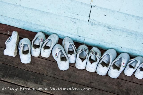 Row of shoes outside classroom, Koh Panyee School (Ko Panyi), Phang Nga Bay, Thailand