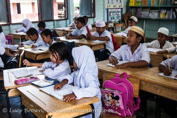 Students in classroom, Koh Panyee School (Ko Panyi), Phang Nga Bay, Thailand