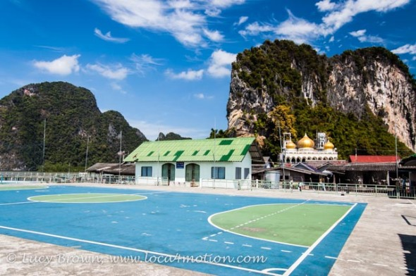Football pitch, mosque and limestone karsts, Koh Panyee School (Ko Panyi), Phang Nga Bay, Thailand