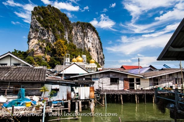 Houses on stilts, mosque and limestone karst, view from Koh Panyee School (Ko Panyi), Phang Nga Bay, Thailand