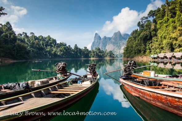 Lakeside raft houses & long tail boat, Cheow Lan Lake, Khao Sok National Park, southern Thailand
